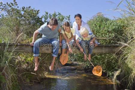 family with fishing nets sitting barefoot
