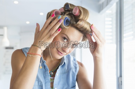portrait of smiling woman with curlers