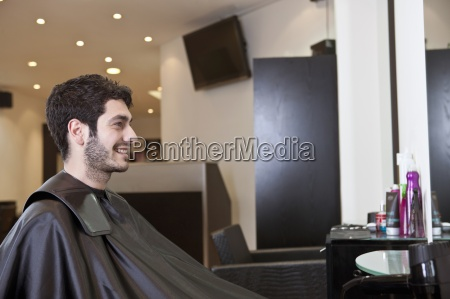 a male client looking at himself