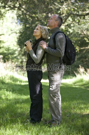 a mature couple outdoors woman holding