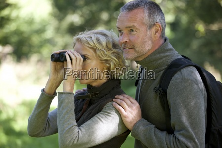 a mature couple outdoors woman looking