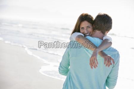 portrait of happy woman hugging man