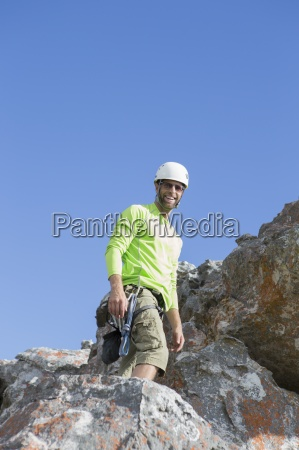 portrait of smiling male rock climber