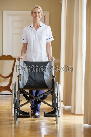 portrait of smiling home caregiver with
