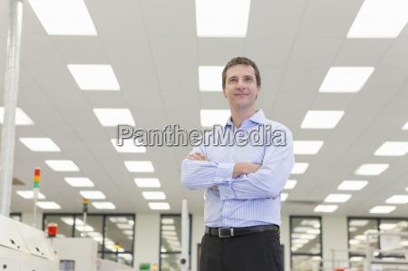 portrait of smiling businessman in hi