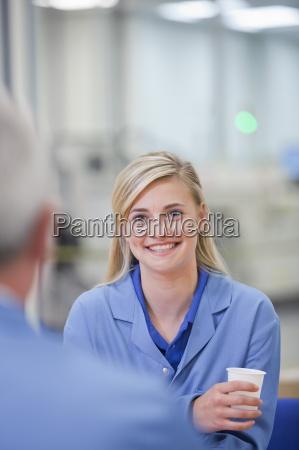 smiling engineers talking