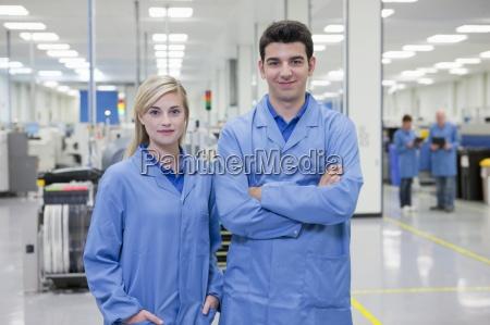 portrait of smiling technicians in hi