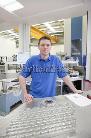portrait of smiling technician with aluminum