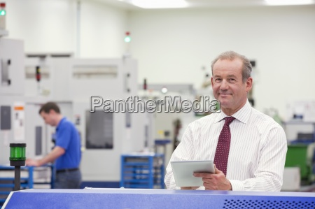portrait of smiling businessman with digital