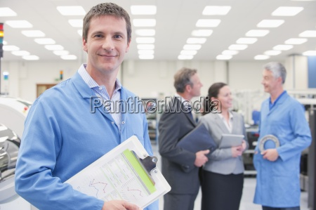 portrait of smiling engineer with clipboard