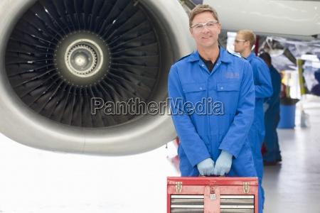 portrait of confident engineer holding tool