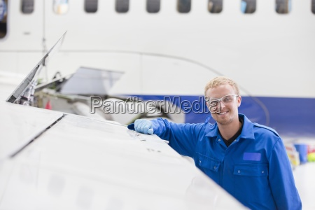 portrait of smiling engineer leaning on