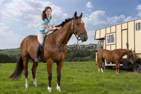portrait of smiling girl on horseback