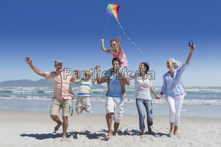 happy multi generation family with kite
