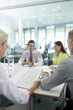 smiling business people meeting in conference