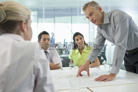 business people discussing map in conference
