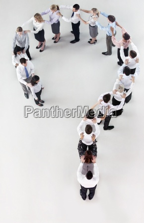 business people forming question mark