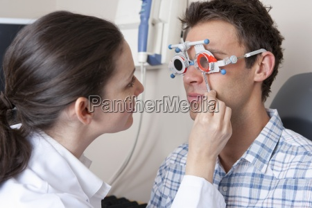 close up of optometrist examining patientx2019s
