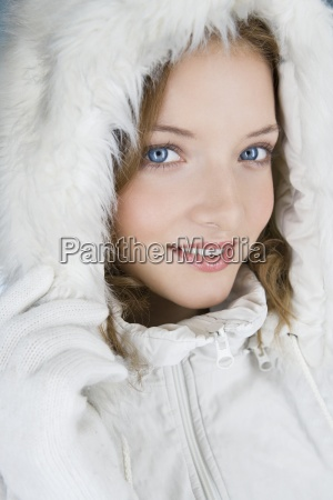 a young woman wearing a winter