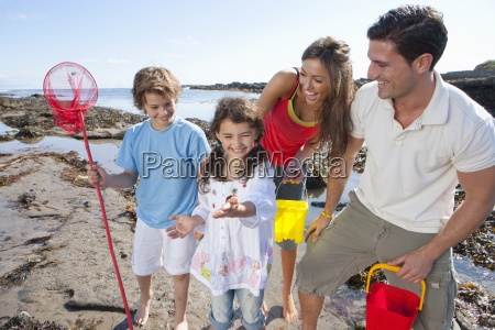 happy family with fishing net and