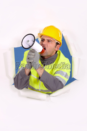 builder shouting into megaphone