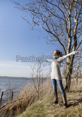 woman enjoying sun in winter