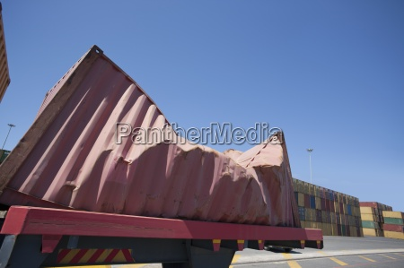 damaged cargo container at commercial dock