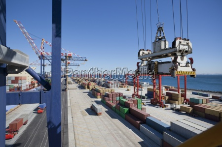 crane above cargo containers on commercial