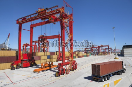 lorry hauling cargo container at commercial