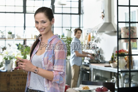 portrait of smiling woman text messaging