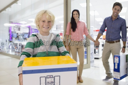 portrait of smiling family leaving electronics