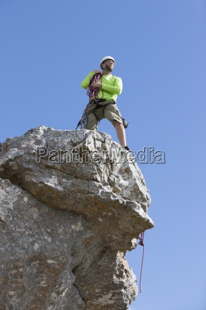 male rock climber looking at view