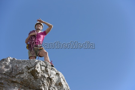 female rock climber looking at view