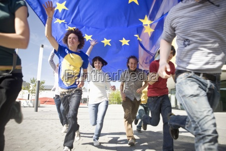 group of young people running with