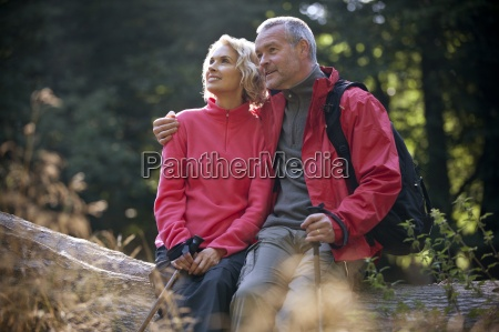 a mature couple sitting on a