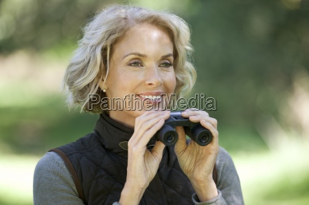 a mature woman outdoors holding a