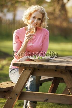 a mature woman sitting at a