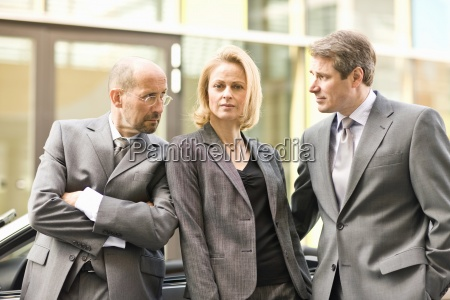three mature colleagues posing in munich