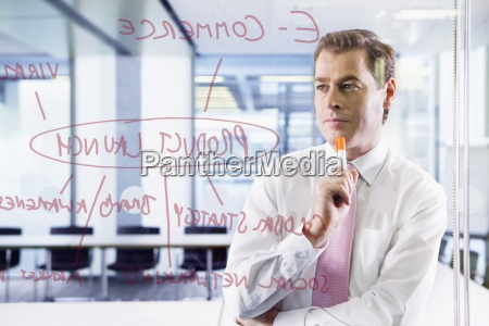 businessman looking at flow chart on