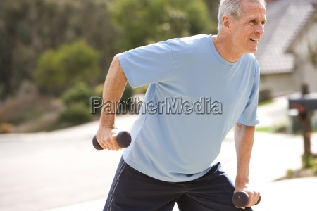 active senior man in blue t