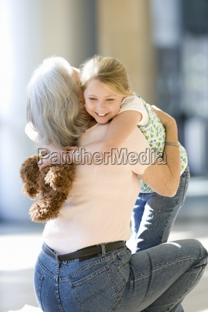 grandmother and granddaughter 7 9 embracing