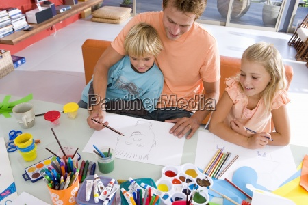 father sitting with son and daughter6