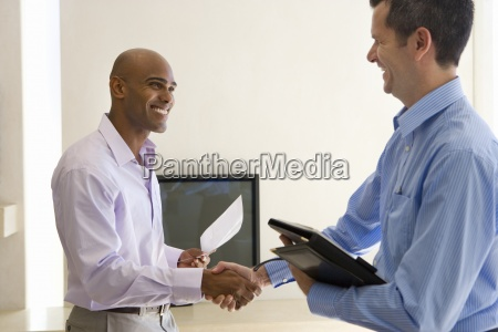 man and male real estate agent