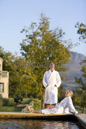 senior couple wearing white bath robe