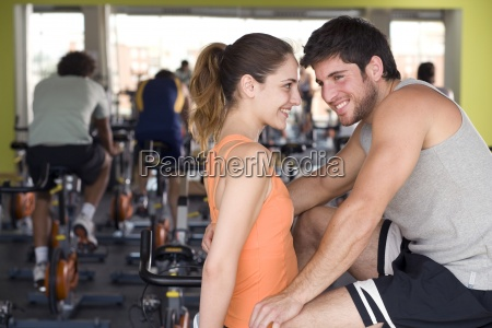 man and woman smiling at each