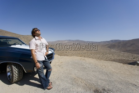 young man in sunglasses leaning on