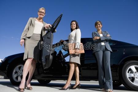 businesswoman with folder by open door
