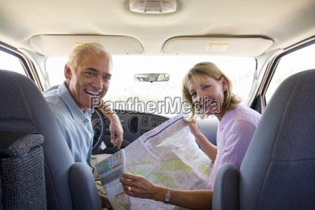 mature couple with map in