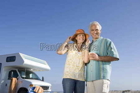 mature couple by motor home on