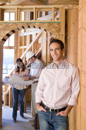 portrait of man smiling by architect